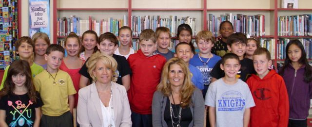 Principal and Assistant Principal with students